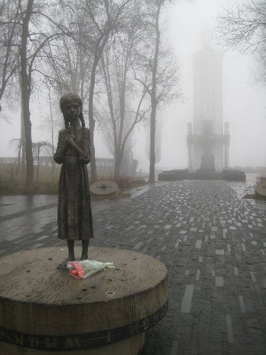 Holodomor memorial (statue in foreground, monument in background