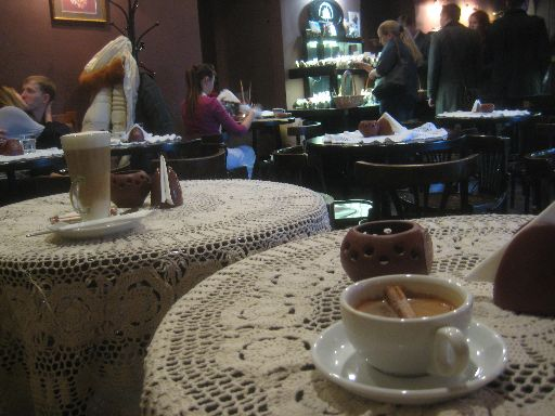 Our drinks at Lviv Chocolate Factory, with shoppers and other patrons in the background