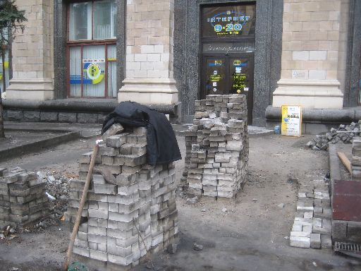 Replacing the sidewalk bricks in front of an Internet café