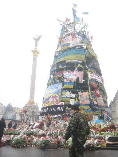 Another view of the 'Christmas tree,' with memorial flowers and candles at the bottom