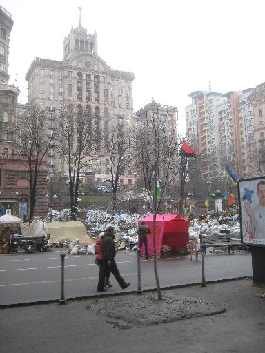 A barricade in front of high-rises, old and new, at the edge of the Euromaidan area going south on Khreshchatyk