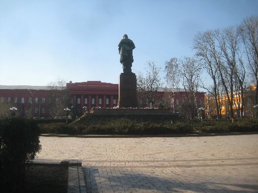 Taras Shevchenko University, behind a statue of the Ukrainian poet; flowers at the base celebrate his 200th birthday on March 9.