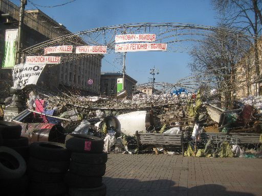 One last good look at a Euromaidan barricade, with clear messages at the top ('Yanukovich - Killer,' 'Berkut - Killer,' 'Party of Regions - Killer')